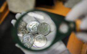 В Україні введено в обіг нові монети номіналом 1 і 2 гривні