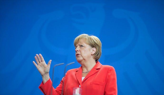 Беженцы должны вернуться домой после окончания войн - Меркель