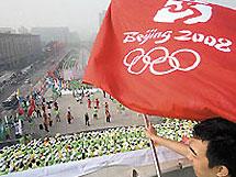 У пекинской олимпиады появились кричалки