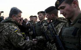 Порошенко приказал повысить зарплату военным, если Россия начнет наземное наступление