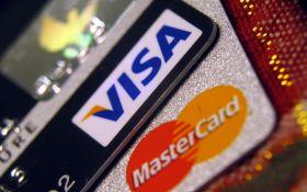 Не тільки SWIFT: російські банки готуються до відключення від міжнародних систем Visa і Mastercard