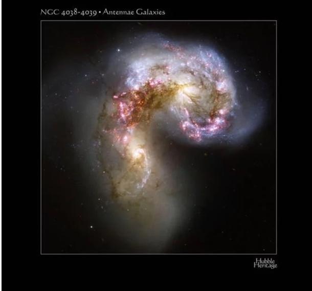 Ученые сфотографировали две галактики, которые разрывают друг друга на части - впечатляющая фотография (1)
