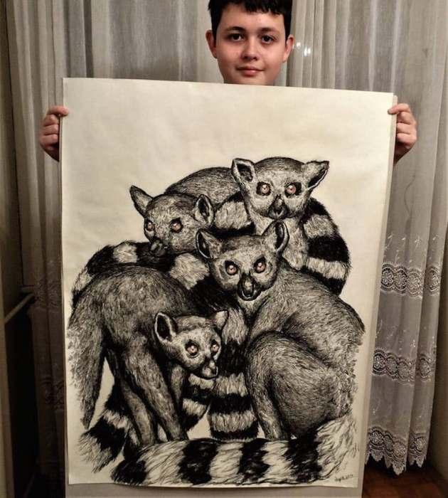 Dusan Ktorlica со своим рисунком.